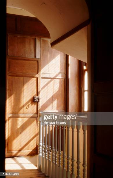 Great Yarmouth Row Houses Norfolk c2000s Interior view of the Old Merchant's House The first floor staircase looking east with sunlight coming...