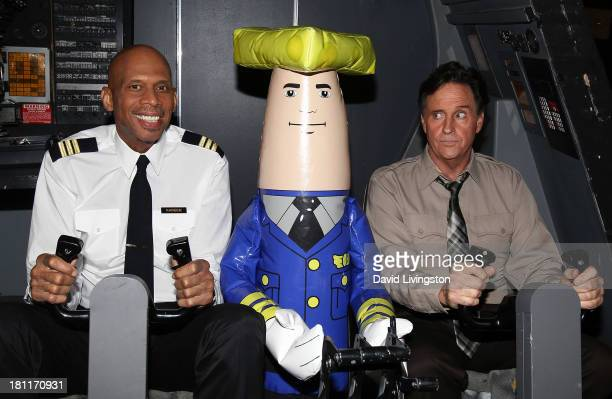 NBA great/actor Kareem AbdulJabbar and actor Robert Hays pose with Otto at the Airplane 30th Anniversary Reunion press announcement at Air Hollywood...