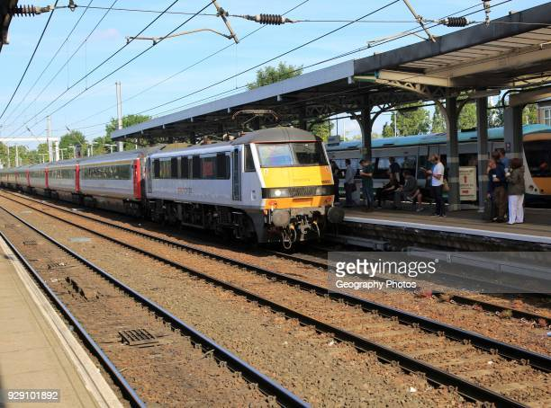 Greater Anglia British Rail Class 90 electric locomotive train platform station Ipswich Suffolk England UK