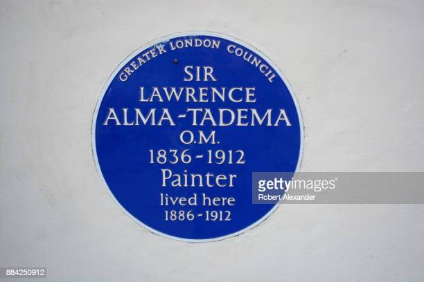 Greater London Council historical marker embedded in the wall in front of a London house indicates that painter Sir Lawrence AlmaTadema once lived in...
