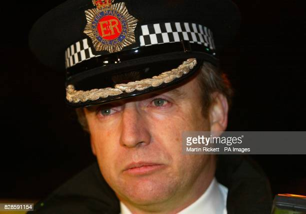 Greater Manchester Assistant Chief Constable Alan Green addresses journalists at the scene on Crumpsall Lane in Manchester where a police officer was...