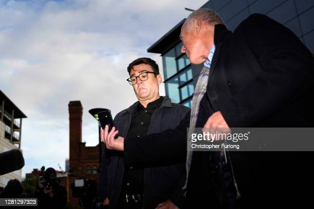 Greater Manchester mayor Andy Burnham with leader of Manchester City Council Sir Richard showing him the news from London when the Tier 3 measures...
