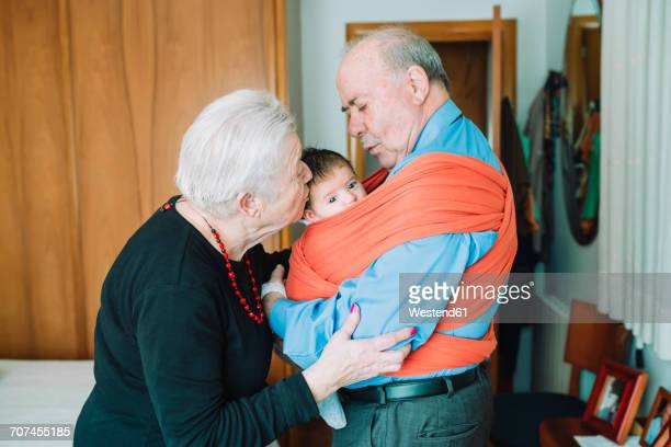 Great-grandfather with his wife carrying baby in a baby sling