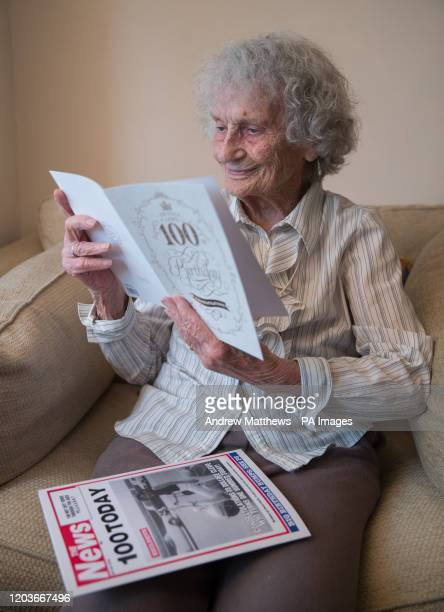 Greatgreat grandmother Doris Cleife reads birthday cards in her flat at Housing 21's Brunel Court in Portsmouth as she prepares to turn 100 years old...