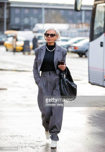 Grece Ghanem is seen wearing grey pants and blazer, black bag outside Rodebjer during Copenhagen Fashion Week Autumn/Winter 2020 Day 3 on January 30,...