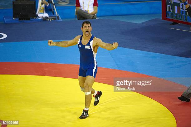 2008 Summer Olympics Italy Andrea Minguzzi victorious after winning Men's GR 84kg Gold Medal Match vs Hungary Zoltan Fodor at China Agricultural...