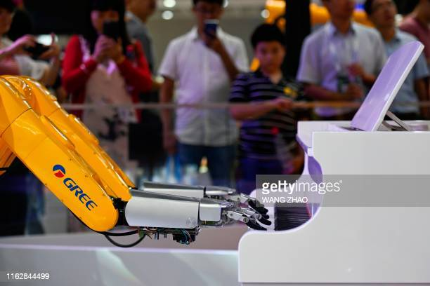 TOPSHOT A Gree robotic arm plays the piano at the 2019 World Robot Conference in Beijing on August 20 2019