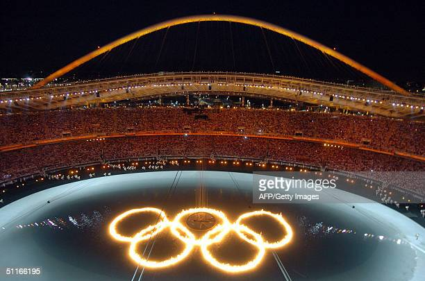 Fire of the Olympic rings are lit in a pool in the Athens Olympic Stadium during the 2004 summer games opening ceremony, 13 August 2004. Some 10,000...