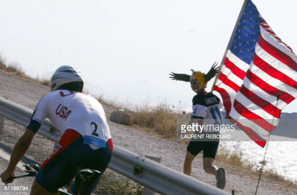 Supporter cheer on US Tyler Hamilton during the men's individual time trial competition at the 2004 Olympic Games, 18 August 2004 in Vouliagmeni, 40...