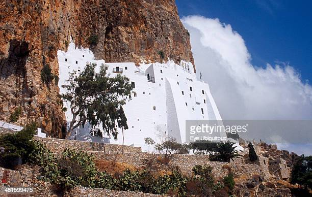 Greece Aegean Islands Amorgos Moni Chozoviotissa Exterior of white painted Byzantine monastery built above terraces on side of steep cliff