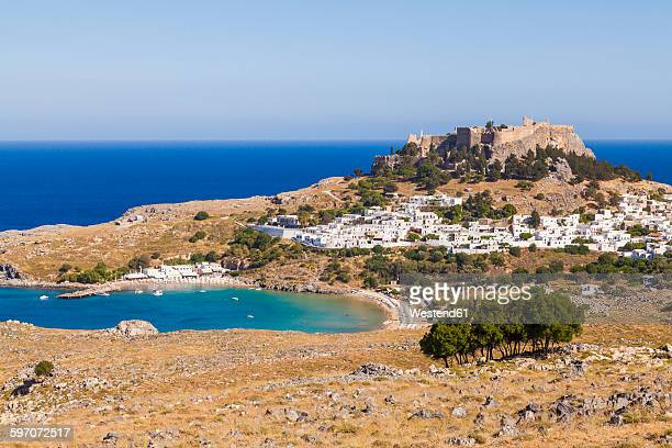 greece, aegean islands, rhodes, lindos, view to acropolis of lindos - lindos stock photos and pictures