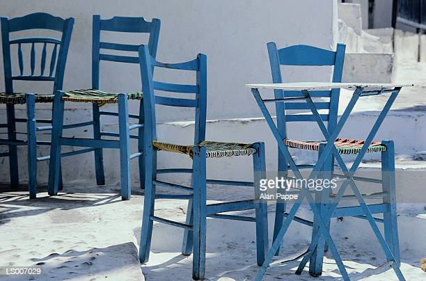 Greece, Aegean, Mikinos, tables and chairs outside cafe