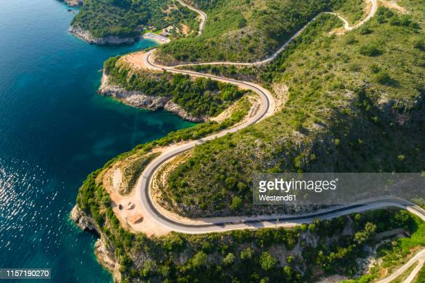 greece, aerial view of coastal road at igoumenitsa - epirus greece stock pictures, royalty-free photos & images