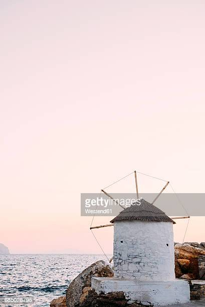 Greece, Amorgos, Aegialis, wind mill at sunset