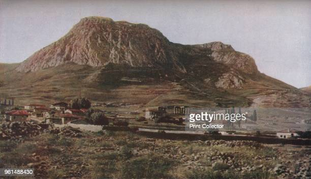 Greece. Ancient Corinth lay at the foot of the frowning hill of Acrocorinth. Of its temple dedicated to Apollo, among the oldest Doric monuments...