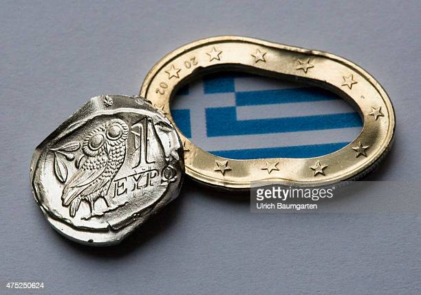 Greece and the Euro Our picture shows a squashed Greek 1 Euro coin with the Greek flag