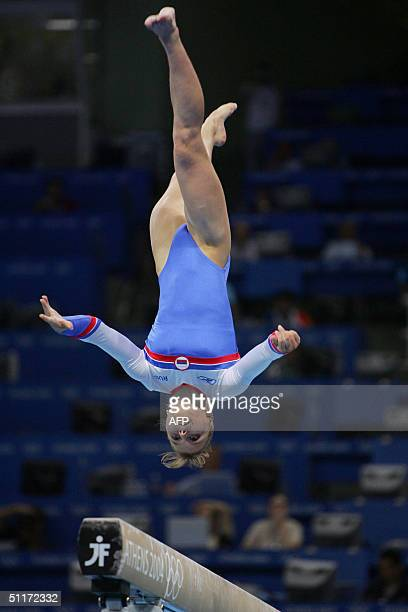Anna Pavlova of Russia performs on the beam during the Artistic Gymnastics qualifications 15 August 2004 at the Olympic Indoor Hall during the Athens...