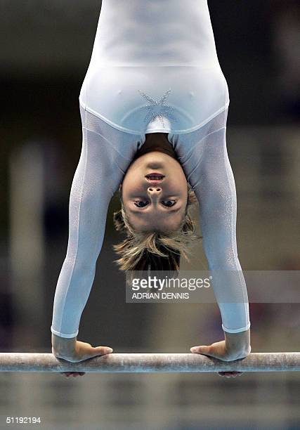 Anna Pavlova of Russia takes part in the uneven bars during the Women's Individual AllAround Gymnastics Final in the Olympic Indoor Hall at the...