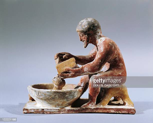 Greece Archaic period 6th century bC Painted terracotta figurine Man grating cheese From Ritsona