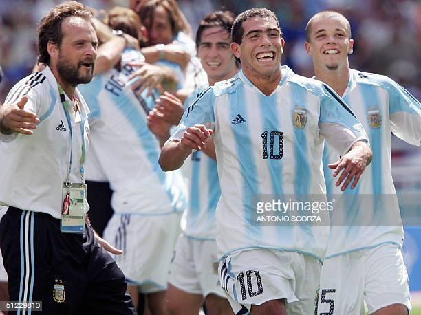 Argentine's Carlos Tevez and Javier Mascherano celebrate with teammates at the Olympic Stadium in Athens 28 August 2004 after the Olympic men's...
