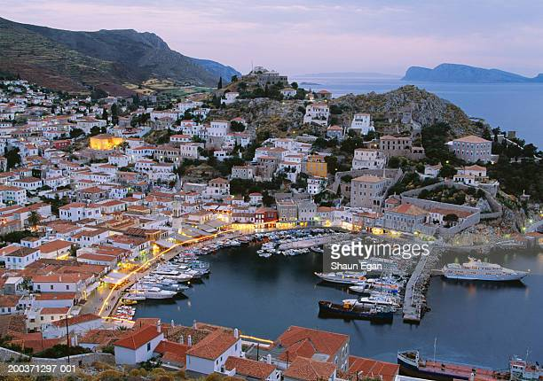 greece, argo saronic, hydra cityscape and harbour, dusk - hydra greece photos stock pictures, royalty-free photos & images