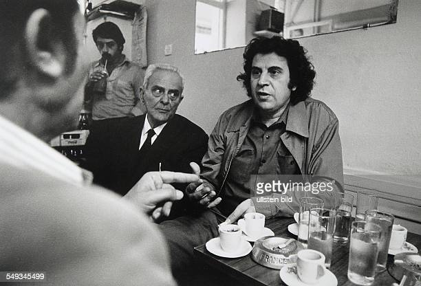 Greece Athens composer Mikis Theaodorakis with his father in a pub
