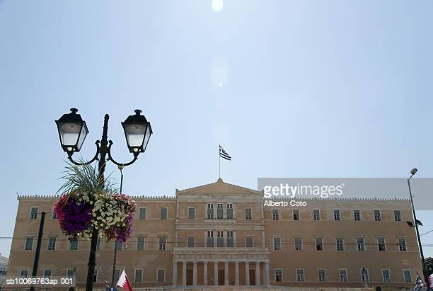 greece, athens, greek parliament with military band in formation - greek parliament stock pictures, royalty-free photos & images
