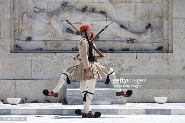 greece, athens, honor guard at tomb of unknown soldier - honor guard stock pictures, royalty-free photos & images