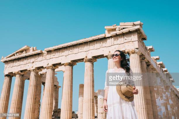 Greece, Athens, smiling woman visiting the Parthenon temple on the Acropolis