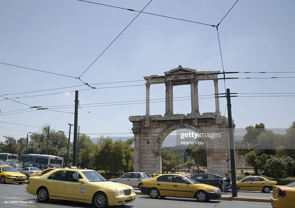 Greece, Athens, Traffic in front of Hadrian Arch : Stock Photo
