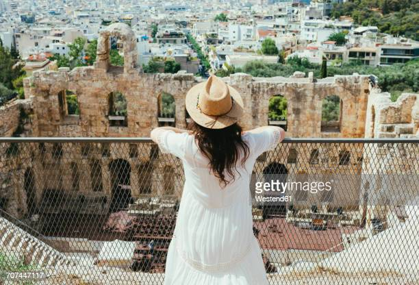 Greece, Athens, woman looking at The Odeon of Herodes Atticus at the slope of the Acropolis