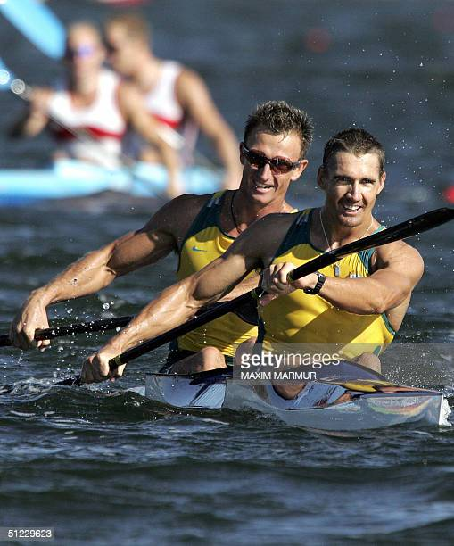 Australian Clint Robinson and Nathan Baggaley smile after finishing second in the Men's K2 500m finalfor the Athens 2004 Olympic Games at the...