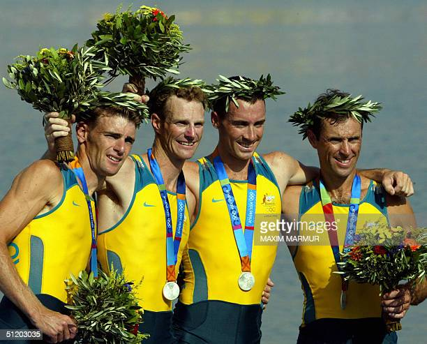 Australian Glen Loftus Anthony Edwards Ben Cureton and Simon Burgess celebrate on the podium after winning the silver medal in the lightweight men's...