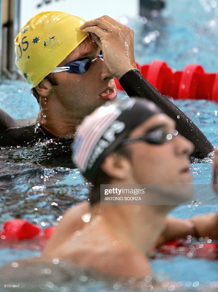 Australian Ian Thorpe (top) and US Michael Phelps look at the screem after the men's 200m freestyle semi-final 2 at the 2004 Olympic Games at the Olympic Aquatic Center in Athens, 15 August 2004.