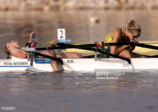 Australian Sally Newmarch and Amber Halliday look disappointed after finishing fourth in the lightweight women's double sculls final 22 August 2004...