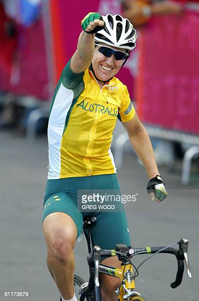 Australian Sara Carrigan celebrates after she crossed first the finish line of the women's road race at the Olympic Summer Games 15 August 2004 in...