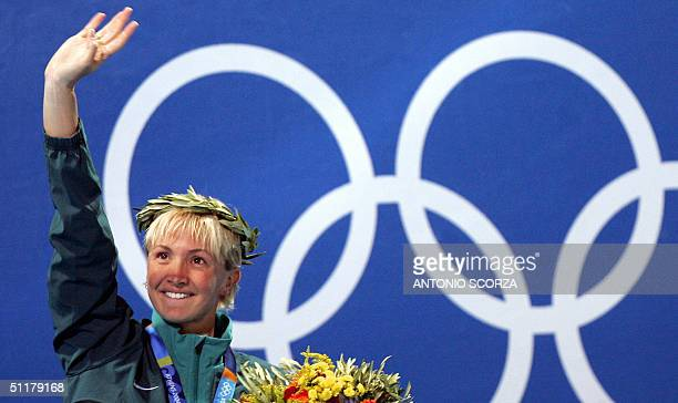 Austrialia's silver medallist Brooke Hanson poses on the podium of the women's 100m breaststroke at the 2004 Olympic Games at the Olympic Aquatic...