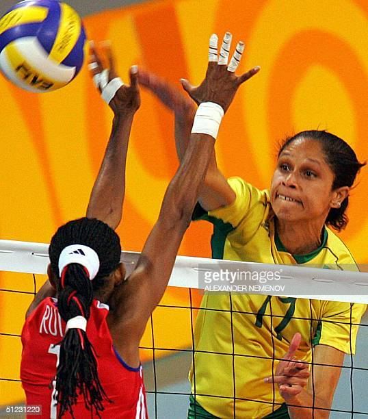 Brazilian captain Fernanda Venturini smashes the ball against Cuban captain Yumilka Ruiz Luaces during the bronze medal volleyball match between...