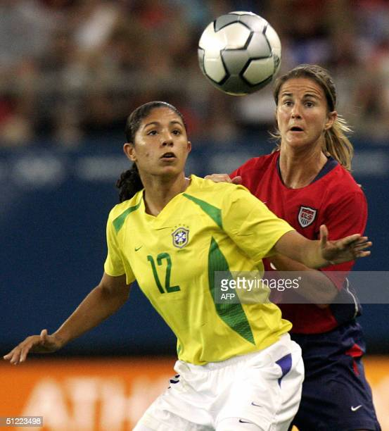 Brazilian forward Cristiane and US defender Brandi Chastain eye the ball during their gold medal football match at the Olympic Games 26 August 2004...