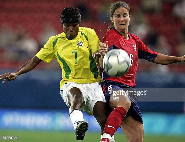 Brazilian midfielder Formiga and US defender Brandi Chastain try to intercept the ball during their gold medal football match at the Olympic Games 26...