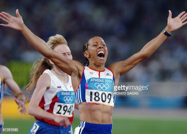 Britain's Kelly Holmes reacts after winning the women's 1500m final ahead of Russia's Tatyana Tomashova at the Olympic Stadium 28 August 2004 during...