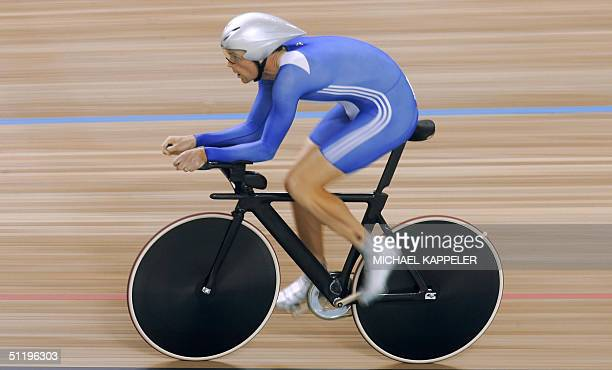 British cyclist Rob Hayles rides during the fifth heat of the men's individual pursuit qualifying against German Robert Bartko at the Athens...