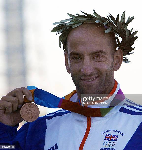 British Ian Wynne shows his bronze medal during the medal ceremony for the Men's K1 500m final for the Athens 2004 Olympic Games at the Schinias...
