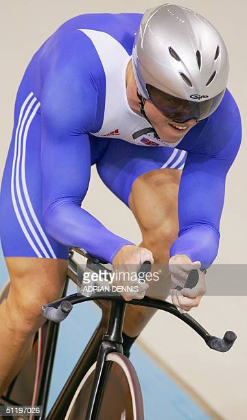 Briton Chris Hoy rides during the men's 1 km time trial final at the Athens velodrome during the cycling track competition at the 2004 Olympic Games,...