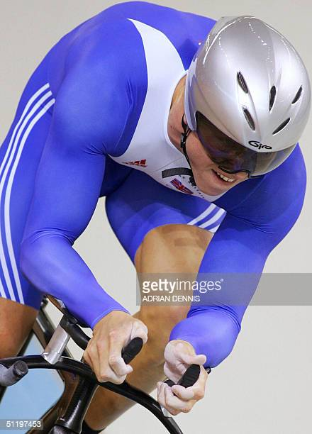 Briton Chris Hoy rides during the men's 1 km time trial final at the Athens velodrome during the cycling track competition at the 2004 Olympic Games...