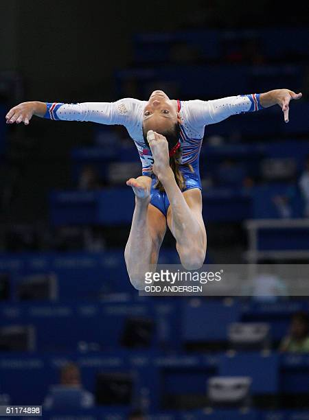 Camille Schmutz of France performs on the beam in the women's Artistic Gymnastics qualifications 15 August 2004 at the Olympic Indoor Hall during the...