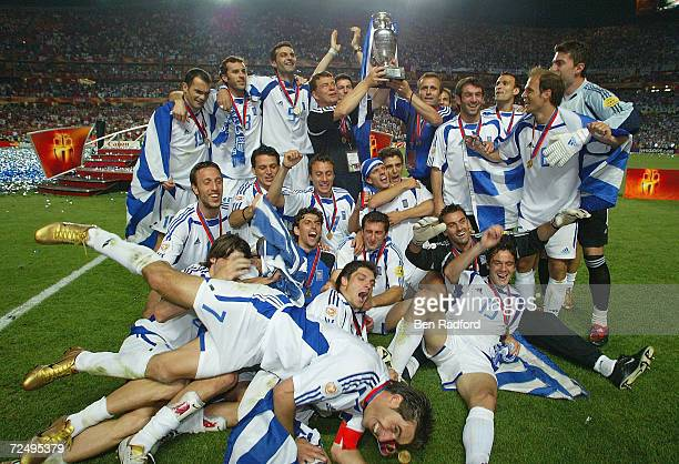 Greece celebrate with the trophy after winning the UEFA Euro 2004 Final match between Portugal and Greece at the Luz Stadium on July 4 2004 in Lisbon...