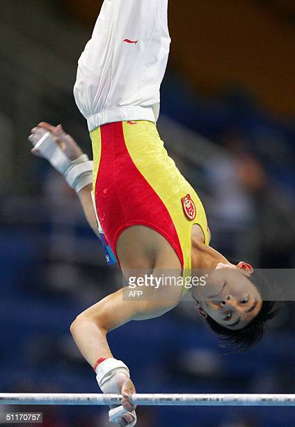 Chinese Haibin Teng performs during the men's gymnastics artistic qualification 14 August 2004 at the Olympic Indoor Hall during the Athens 2004...