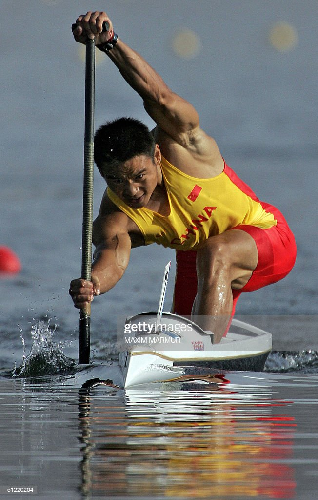 Chinese Wang Bing powers to finish third during the Men's C1 500m semi-finals for the Athens 2004 Olympic Games at the Schinias Rowing and Canoeing Center, outside Athens, 26 August 2004.