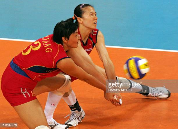 Chinese Yang Hao and her teammate Zhou Suhong receive the ball during the gold medal volleyball match between Russia and China at the Olympic Games...